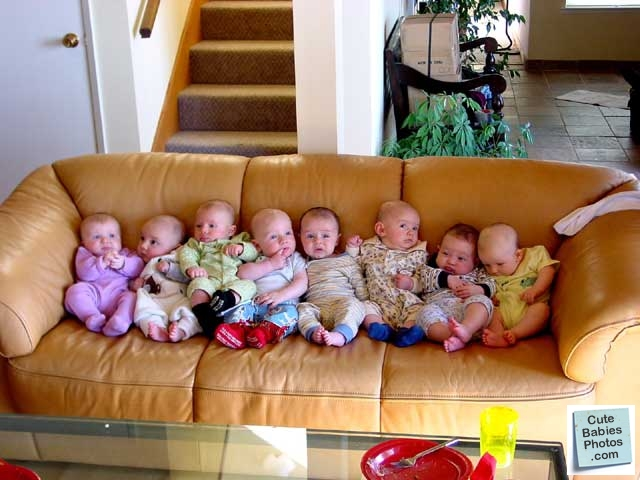 Group of babies on couch